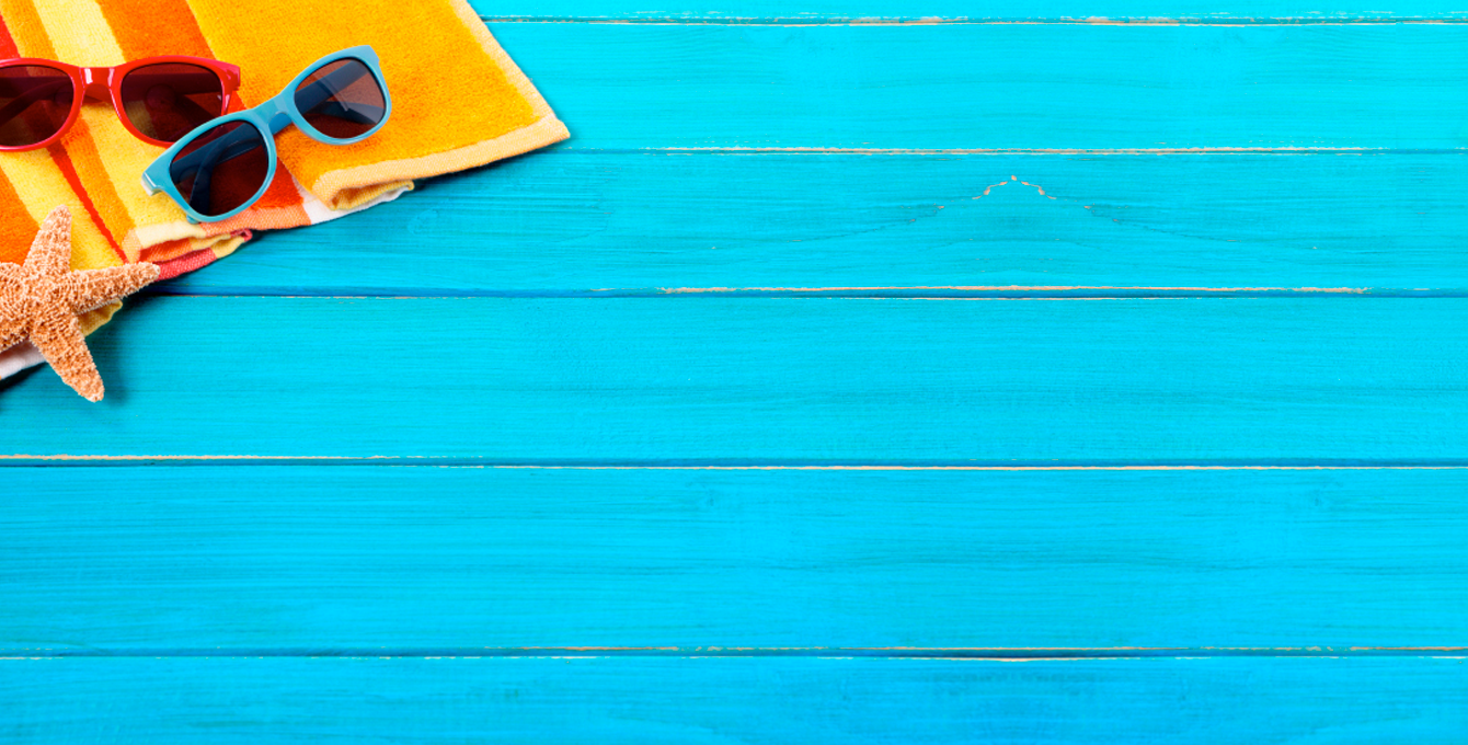 beach accessories on a blue boardwalk