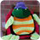 small button, photo of turtle plush, links to TCES homepage